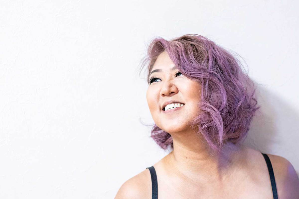 Asian girl with short purple hair