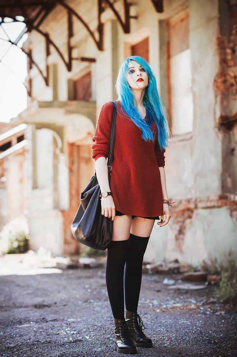 Attractive blue-haired grunge girl among the industrial ruins