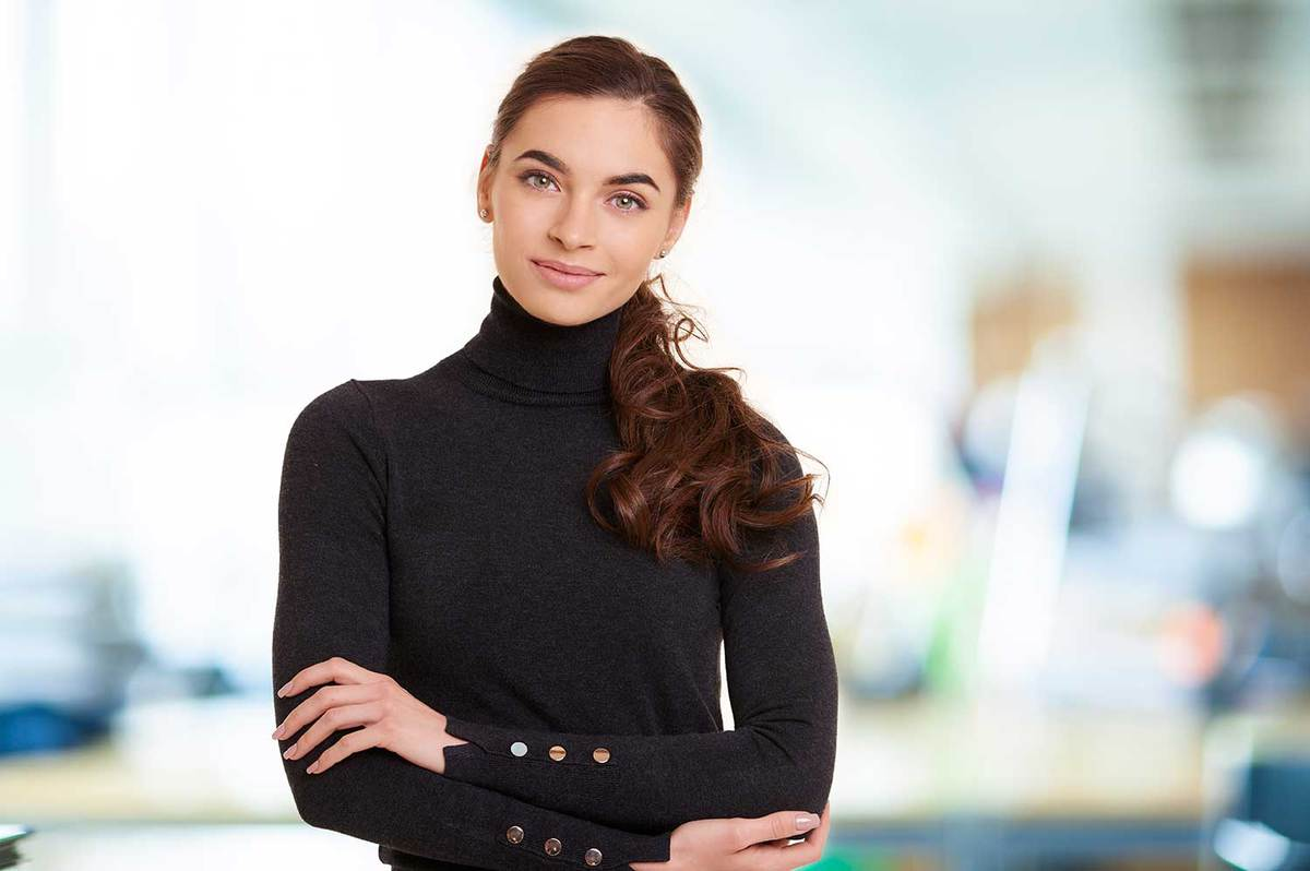 Attractive young woman wearing black turtle neck