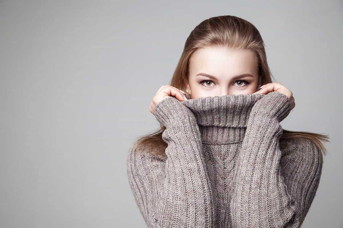 Beautiful blonde young girl wearing winter pullover turtle neck