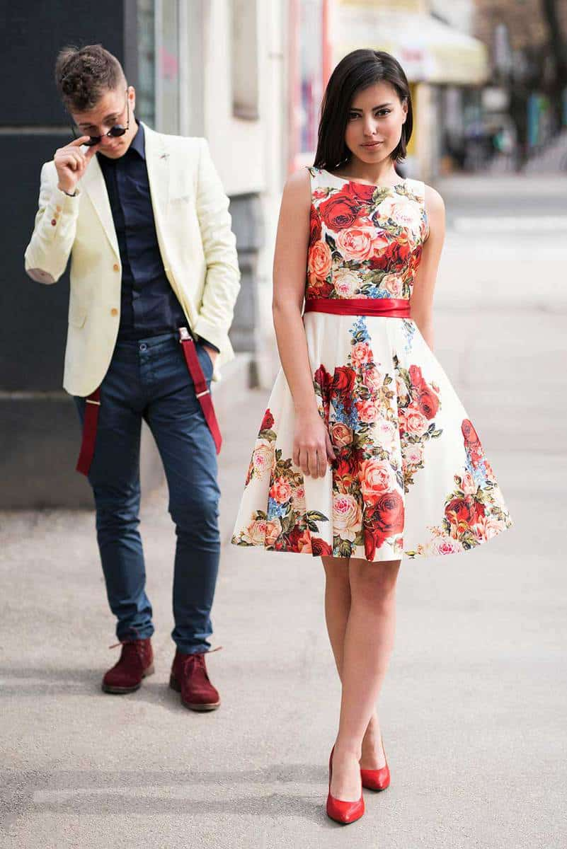 Beautiful woman wearing white floral dress