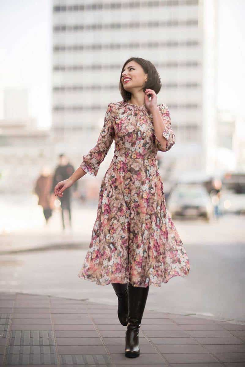 Beautiful young woman wearing long sleeve floral dress