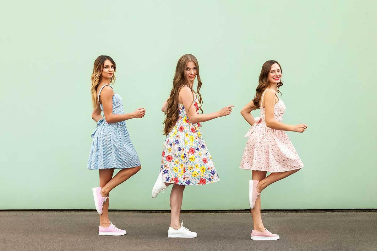 Beautiful young women wearing floral dress posing