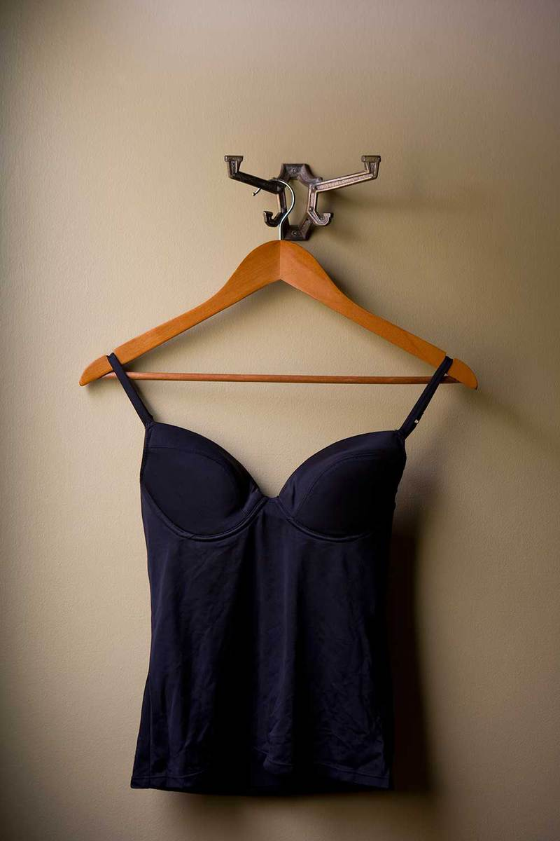 Bra tank top hangs from a hanger