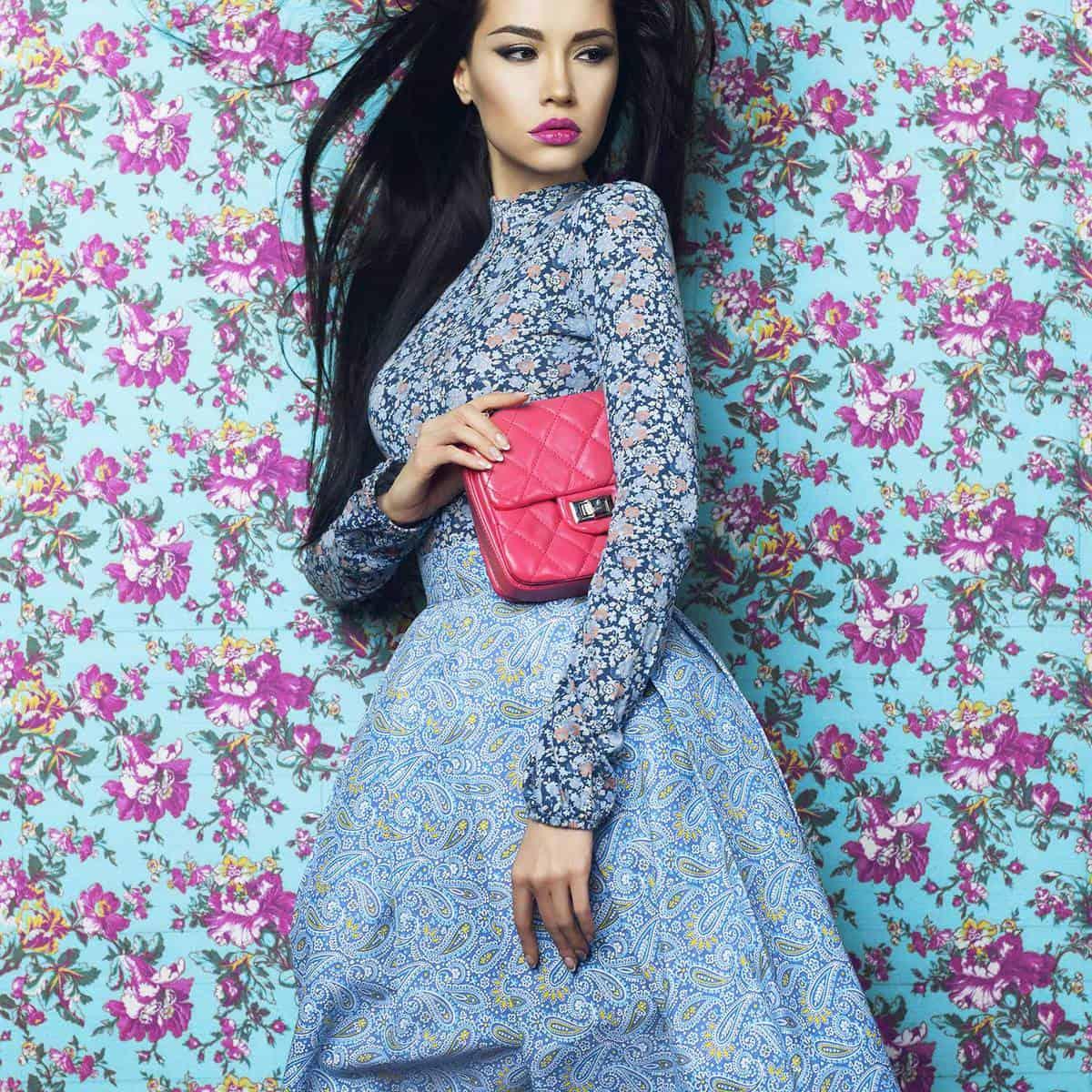 Elegant lady in blue floral dress on floral background
