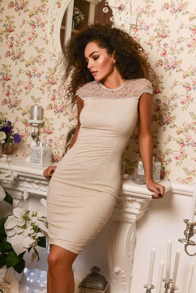 Beige bodycon dress with a lace neckline
