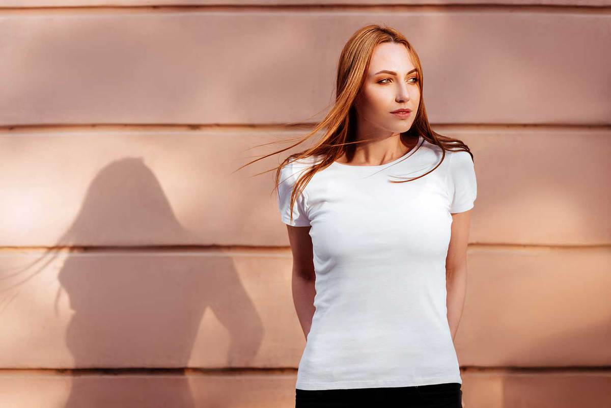 Girl wearing blank white t-shirt and jeans on the side of a street