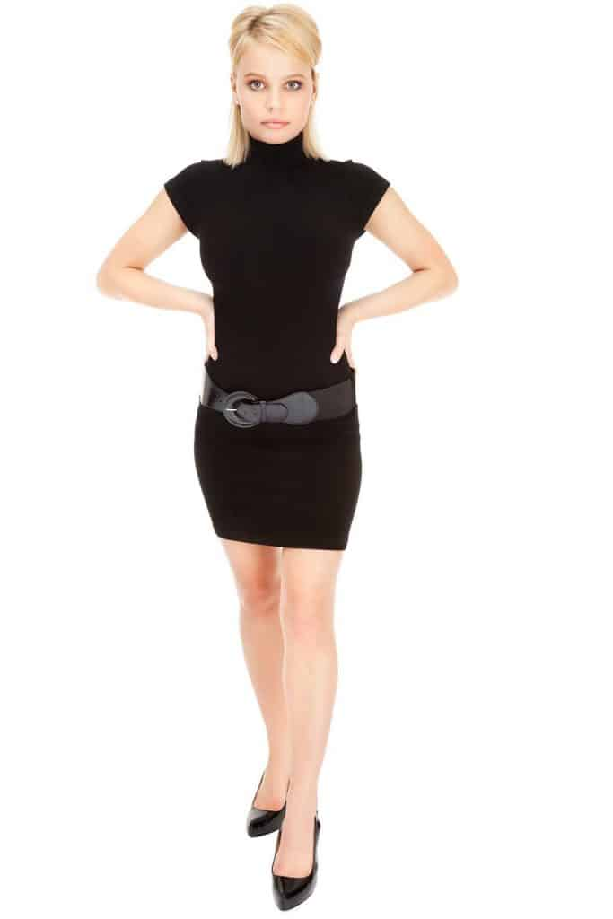 A black bodycon dress that's worn with a belt around the hips
