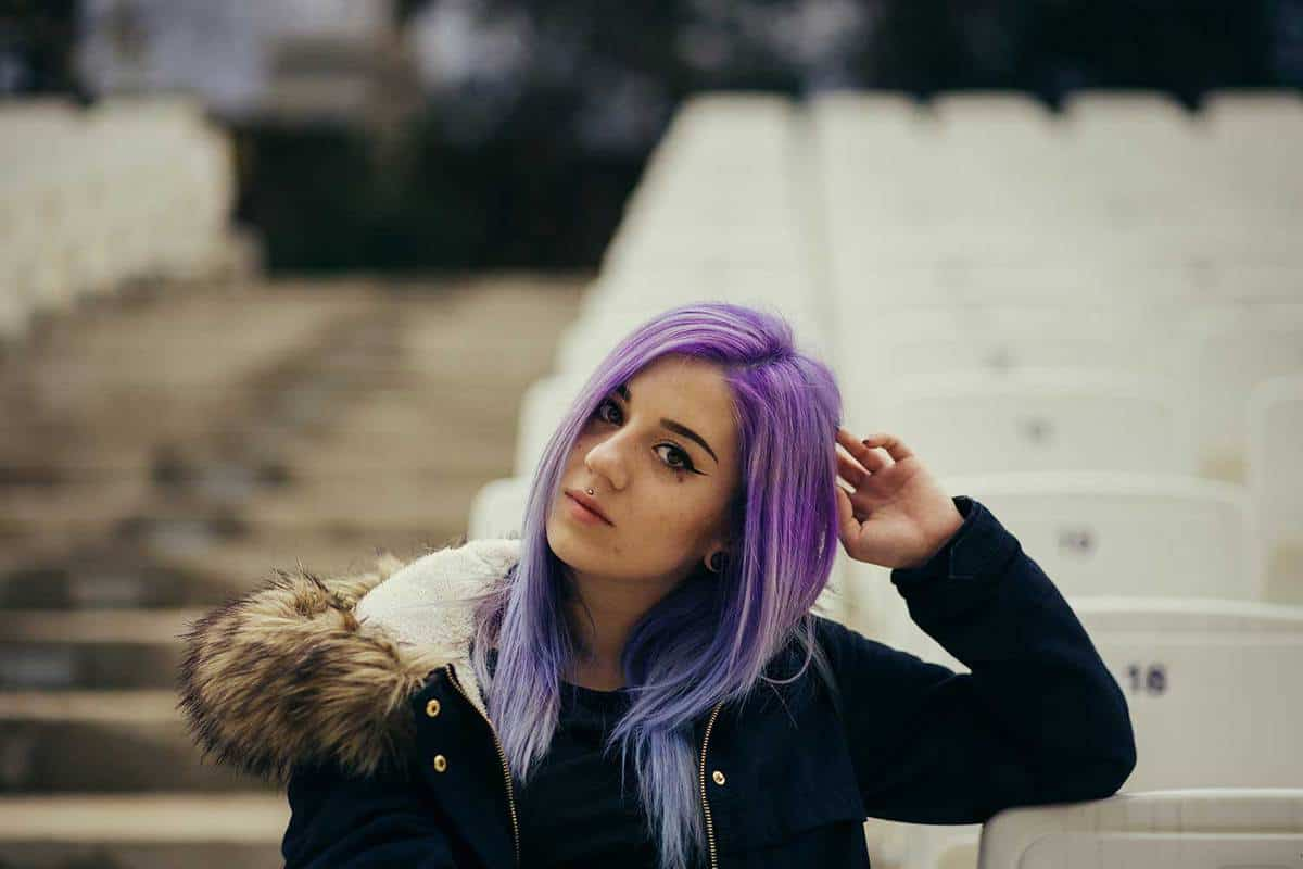 Teenage girl with purple hair in the stadium