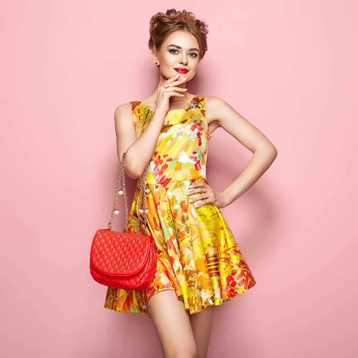 Woman in golden floral spring summer dress