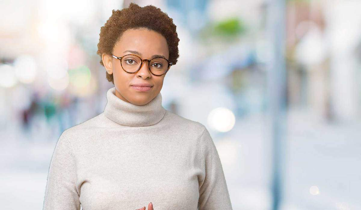 Young beautiful african american woman wearing glasses and turtle neck