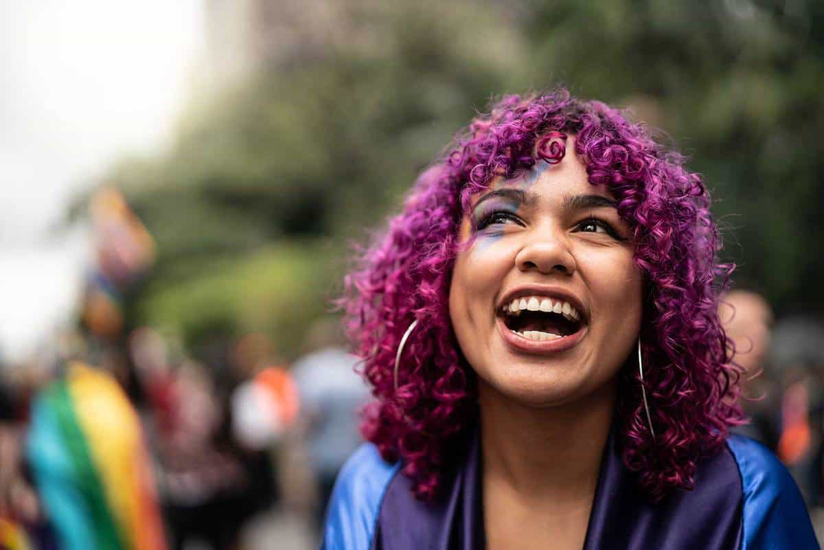 Young girl with purple hair smiling