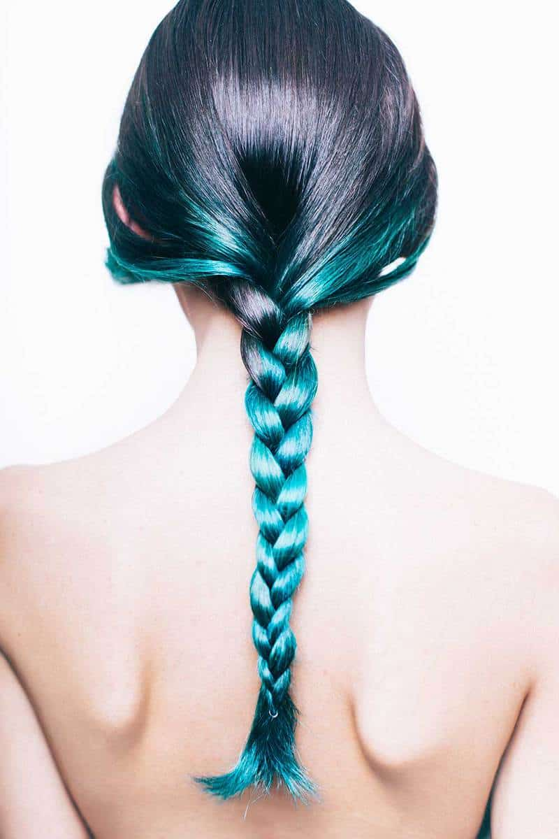Young woman with a green ombre braided hair
