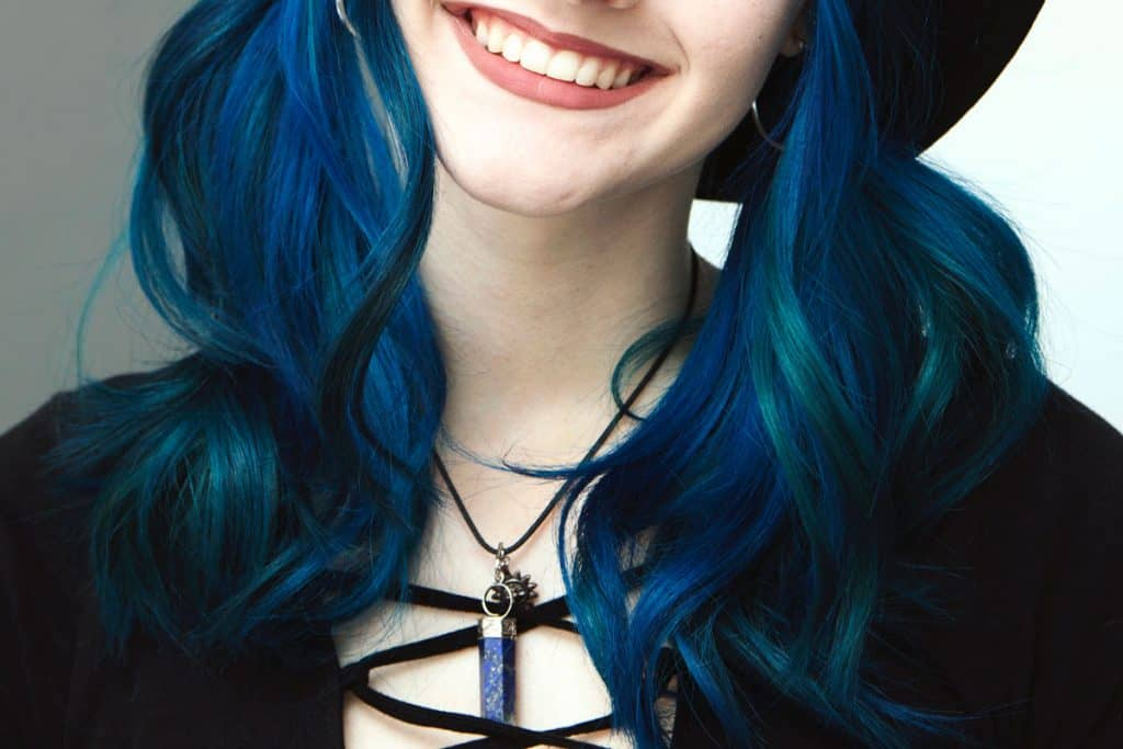 Smiling girl with blue hair, 101 Blue Hair Ideas [Tips, Advice and Pictures]