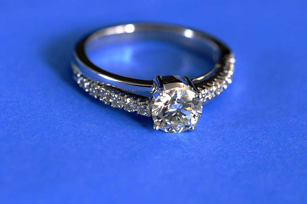 Diamond ring placed on blue table