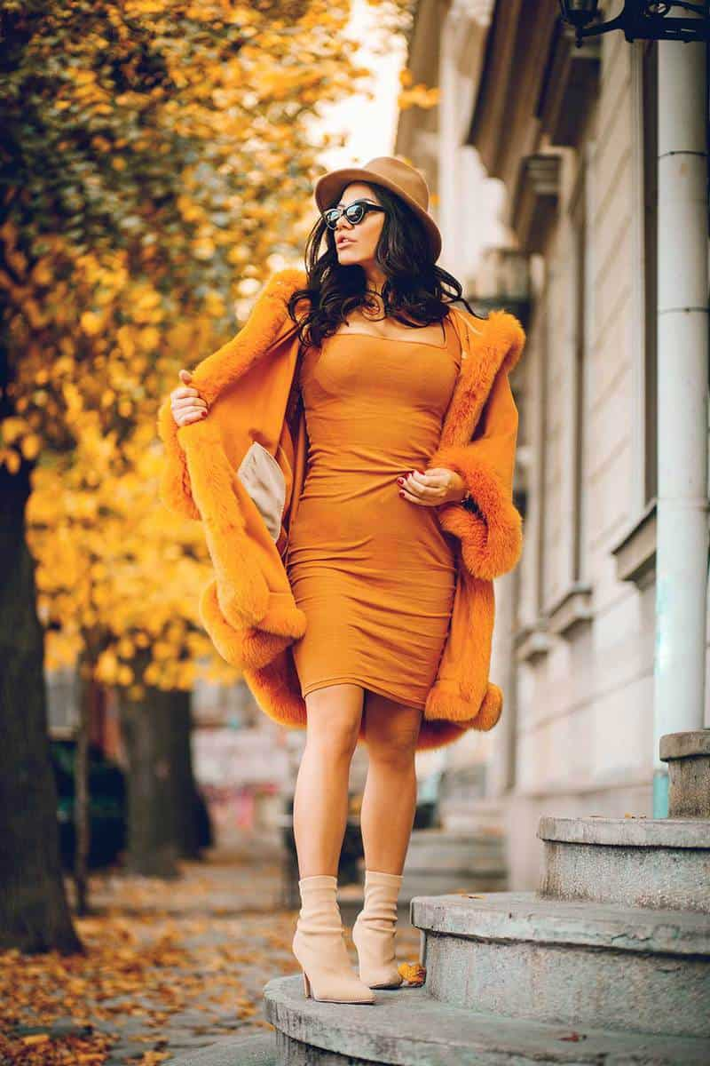 Beautiful fashion model in yellow dress and yellow coat