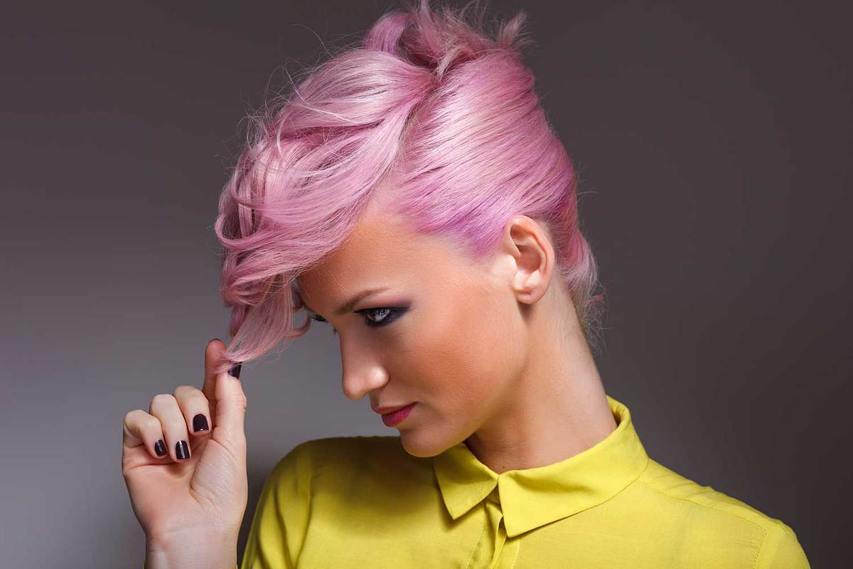 Beauty portrait of young pink haired woman