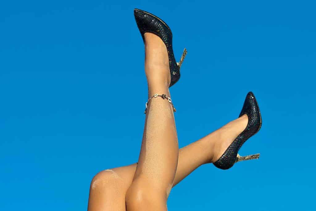 How-Long-Should-An-Anklet-Be, girl's legs up in the air while wearing anklet and heels