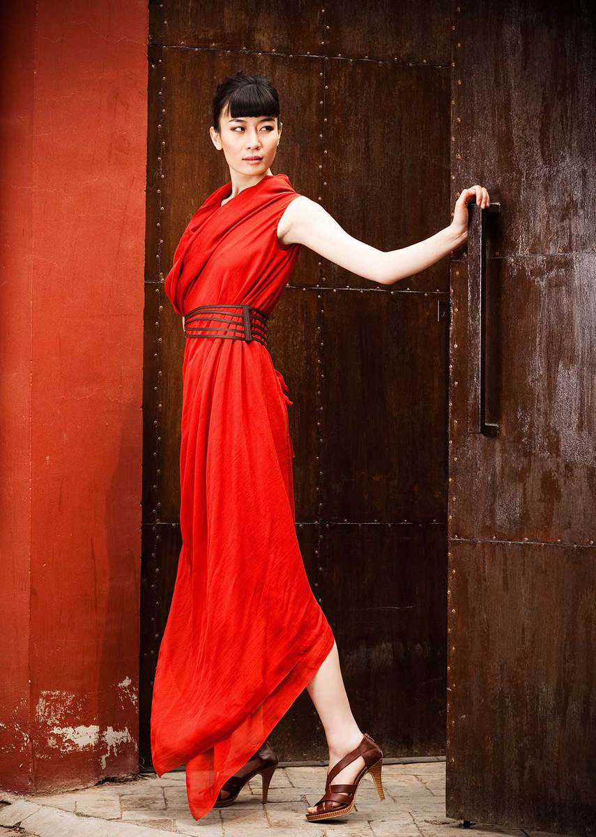 Young asian woman in heals and red dress with belt
