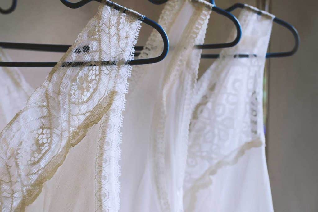 Lace white tank tops on hangers