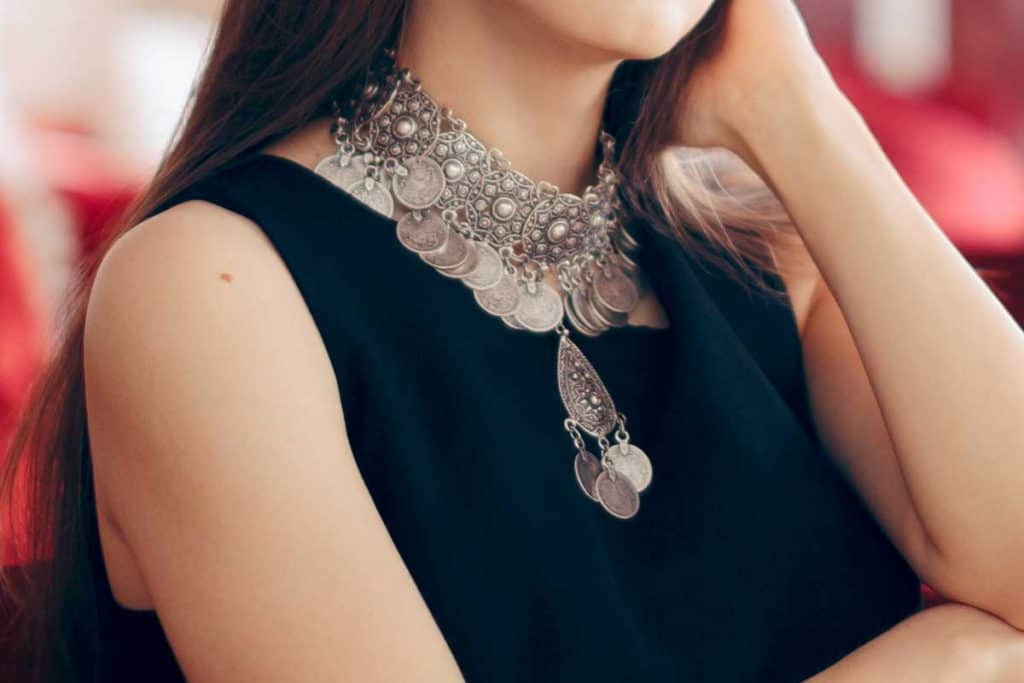Pretty woman wearing statement necklace and black dress