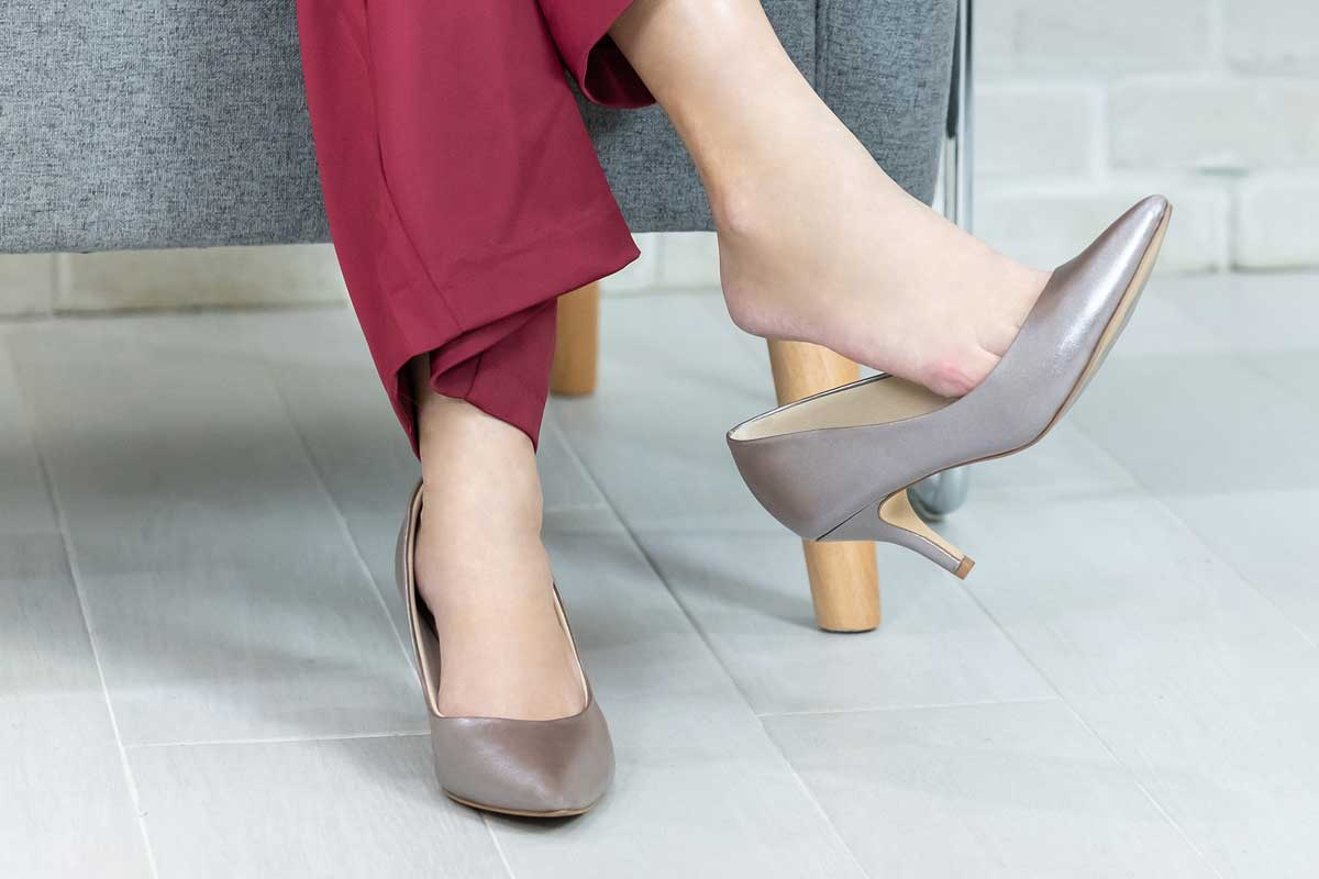 Woman in business attire wearing gray high heels, What to Wear With Gray Shoes? [21 Picture Ideas]