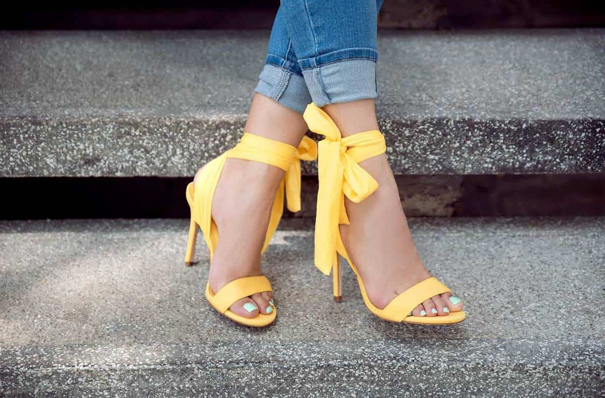 Woman wearing yellow heels sandals outdoors