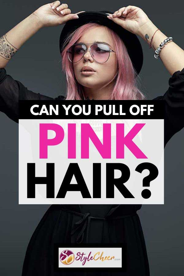 Woman with tattoos and pink hair wearing black dress and hat, Can You Pull Off Pink Hair? [Here's how!]