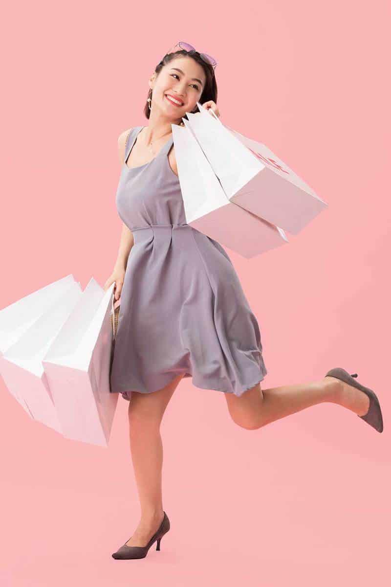 Young women shopping wearing grey dress and grey shoes