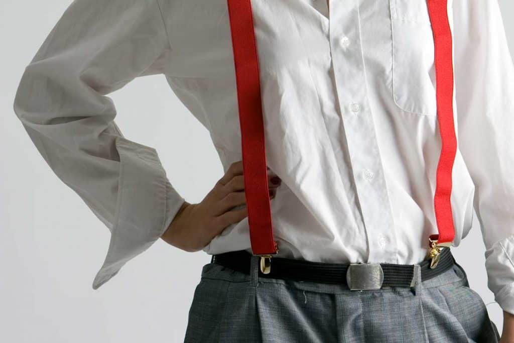 A woman wearing white long sleeve paired with belt and suspender, Should You Wear a Belt With Suspenders?