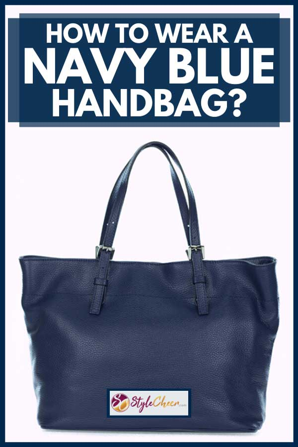 Navy blue handbag on a white background, How To Wear a Navy Blue Handbag?