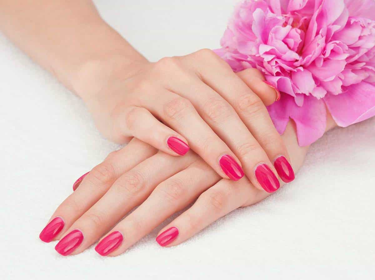 Pink manicure and a flower