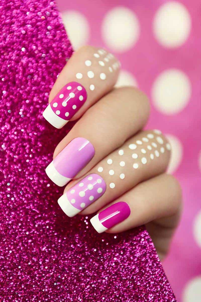 Pink nail polish with white dots