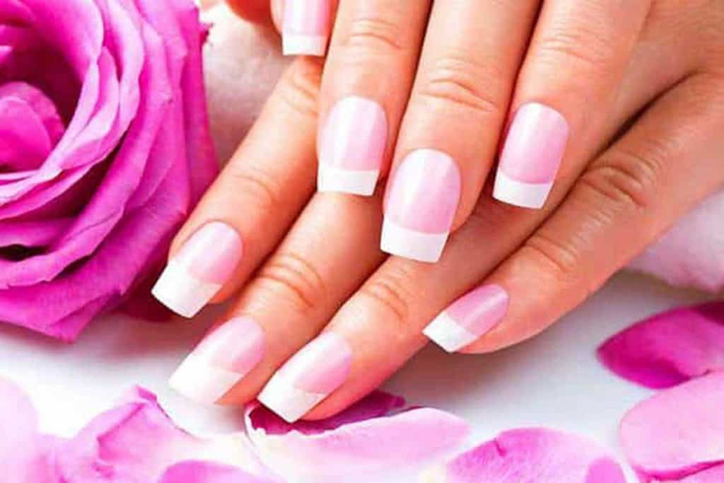 Stylish pink manicure with pink rose and petals, 28 AWESOME Pink Nails Ideas you should check out