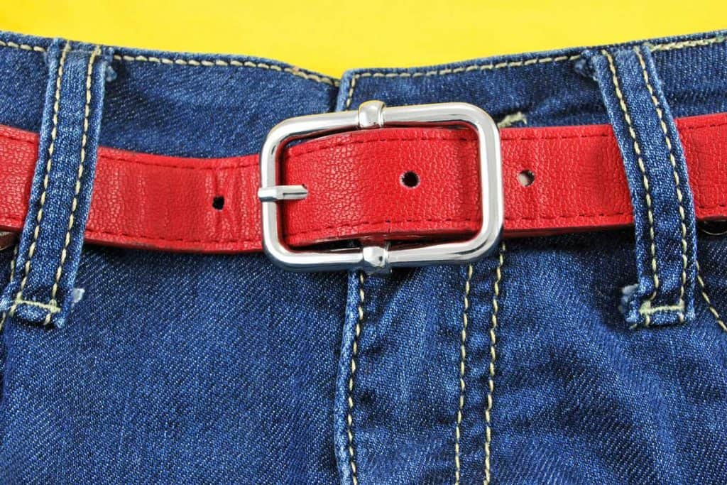 women jeans with red leather belt