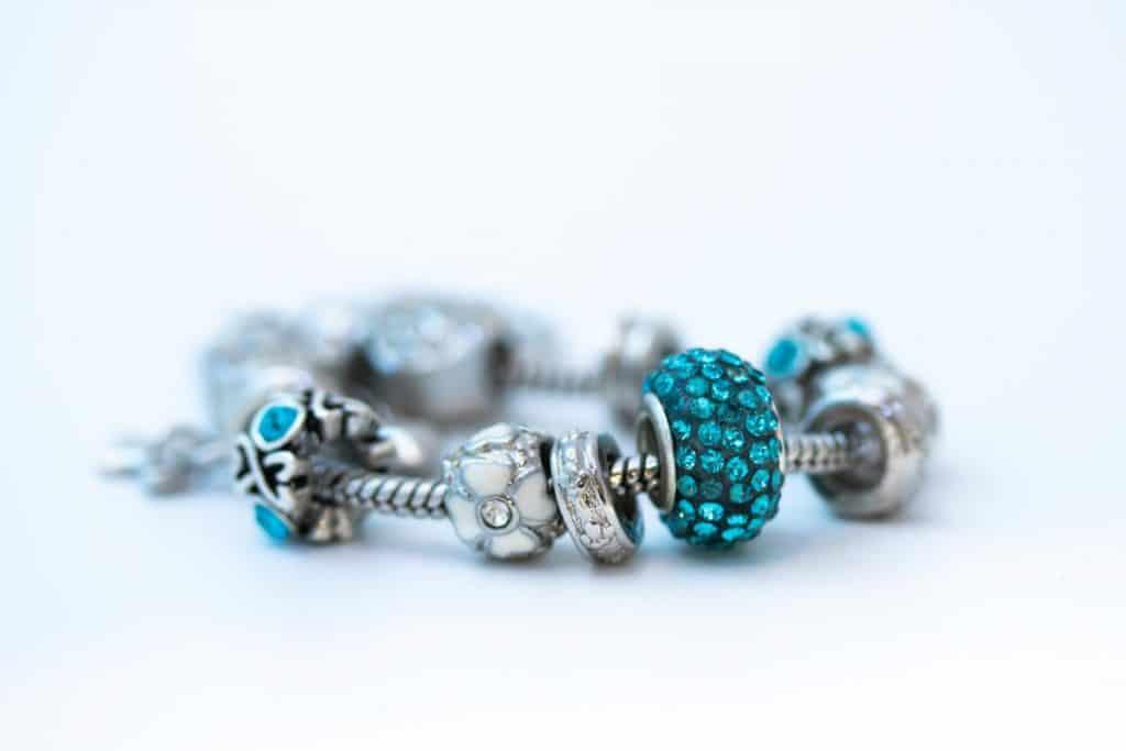 A Pandora bracelet with blue gems attached to the bracelet, My Pandora Bracelet Turned Black - What To Do?