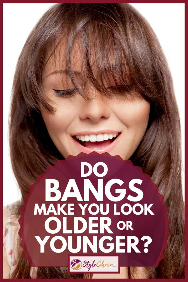 Smiling beautiful young brunette with long hair and bangs, Do Bangs Make You Look Older or Younger?