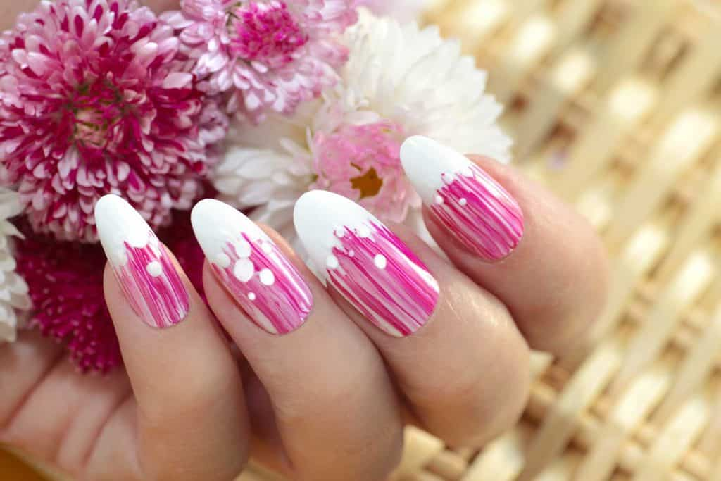 French oval manicure with a striped gradient in pink tones