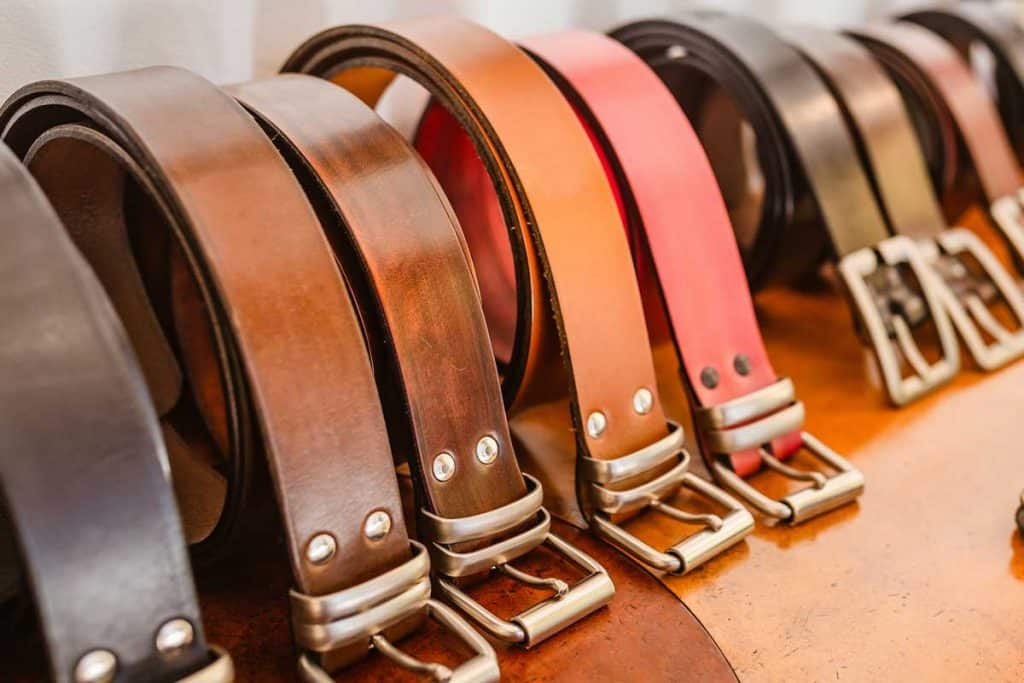 Handmade leather belts for sale in a stand of the crafts market, How Much Does a Leather Belt Cost?