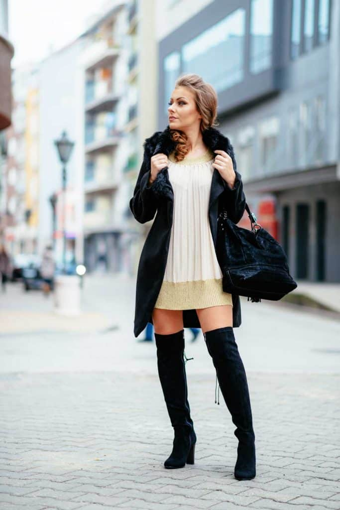 Portrait of beautiful young woman, 20 years old in city downtown, wearing high-end fashion, cute winter dress