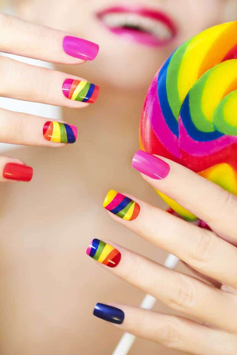 Rainbow manicure on artificial square shape nails