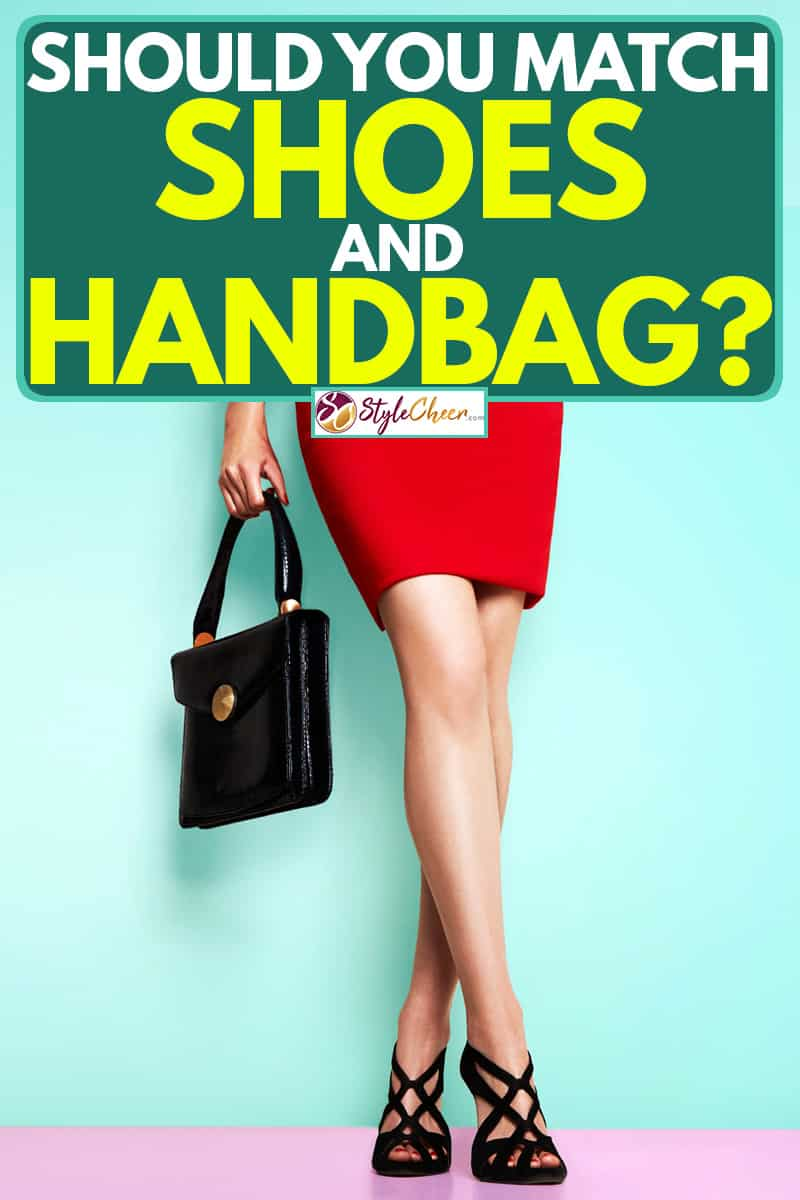 A woman wearing a tight red dress and black shoes wile holder her black handbag, Should You Match Shoes and Handbag?