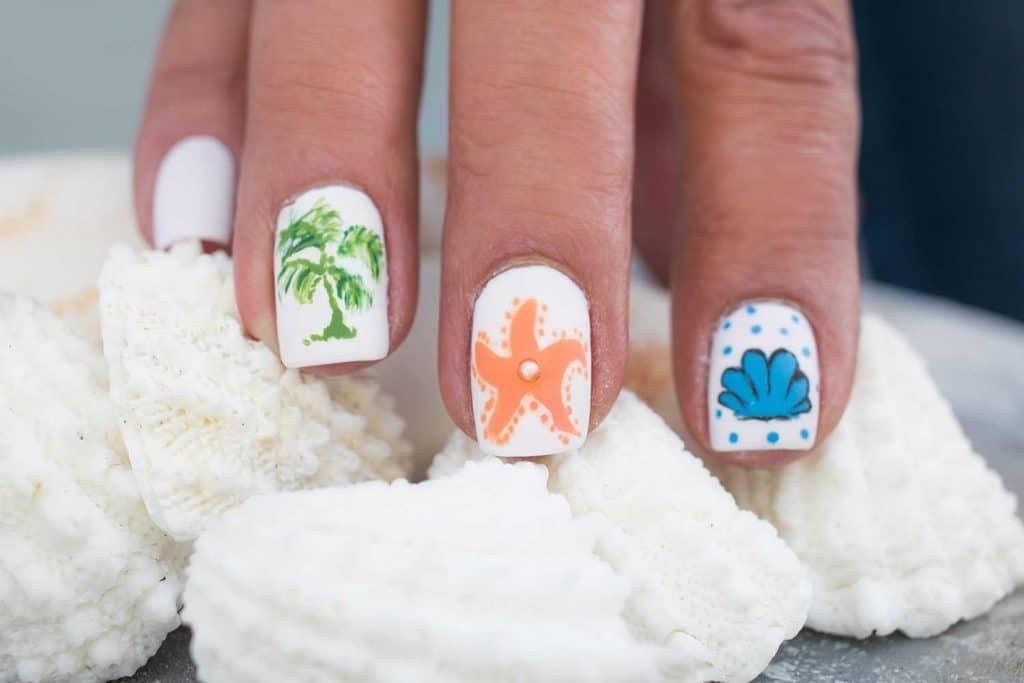 Starfish and palm tree nail art design