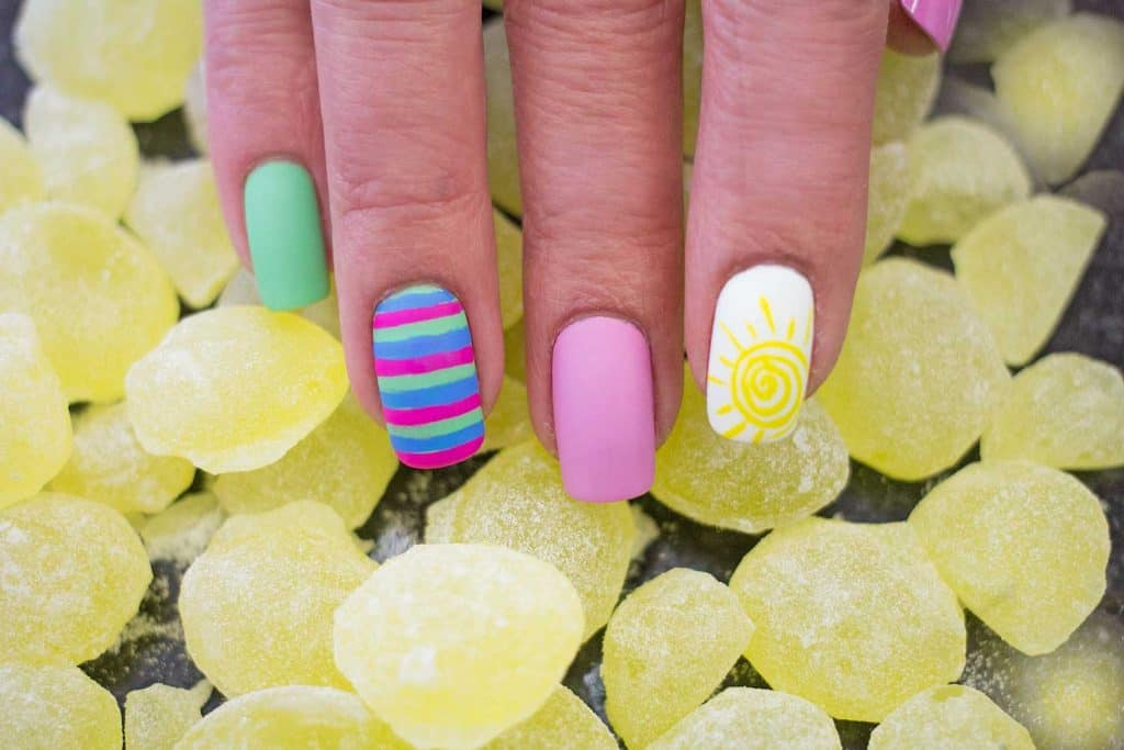 Summer inspired colorful striped nail art design