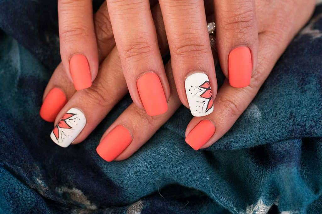 Summer inspired coral flower nail art design