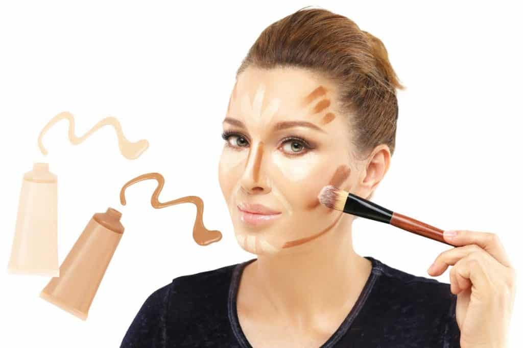 A woman applying contour and highlight makeup, Do You Have to Wear Foundation to Contour?