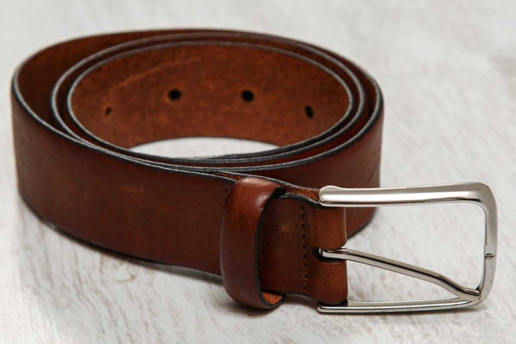 Close up photo of a leather brown belt, What Can I Use Instead of a Belt? [5 Belt Alternatives]