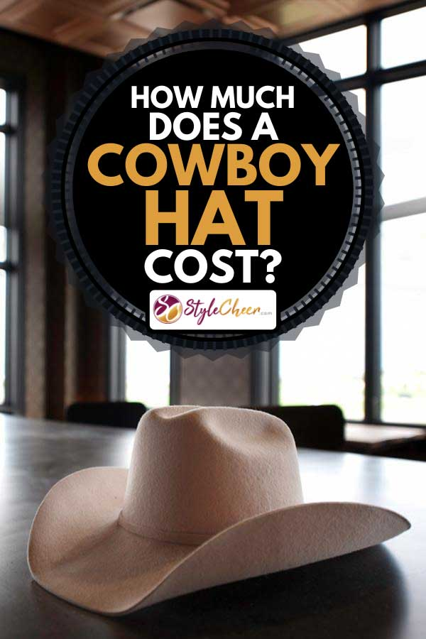 Cowboy hat lays on the bar in a an urban style saloon, How Much Does A Cowboy Hat Cost?