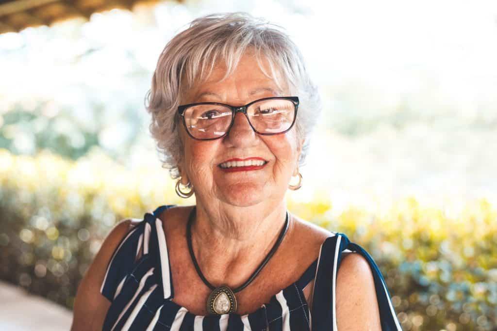 Mature woman looking at camera smiling