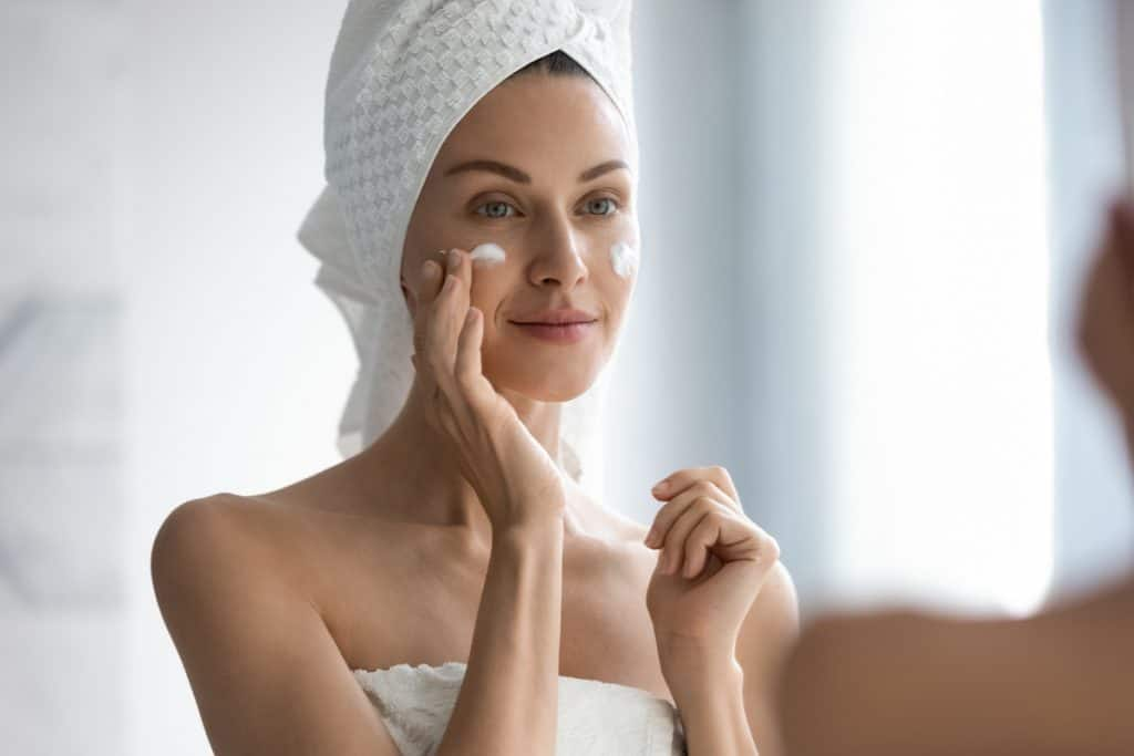 An attractive woman putting on moisturizer on her face, Is It Bad To Use Moisturizer Every Day?